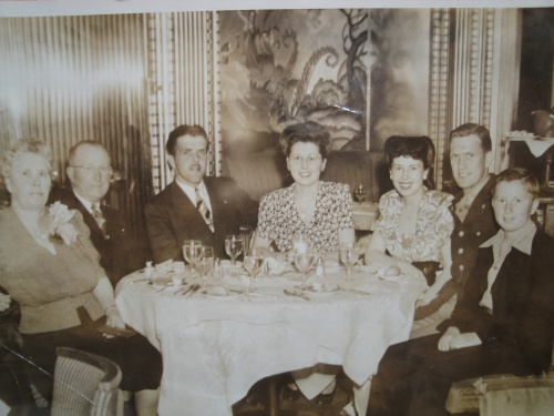 The Mickelsen family in a restaurant in the 1940s. The couple in the center are Evelyn and her husband. There is a young Ron Mickelsen there and on the left Chris and Anna Mickelsen.