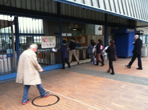 People entering the BART station after it was closed for two hours due to a death on the tracks. Photo by Carolyn Deacy.