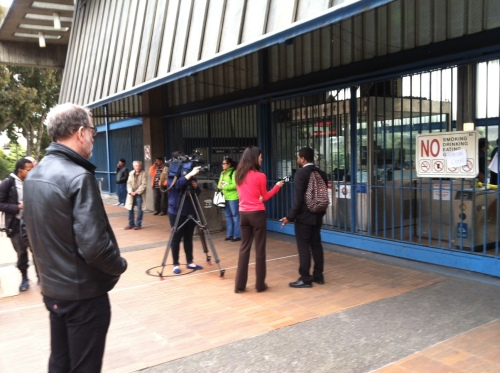 Reporters interviewing people at Glen Park BART. Photo by Carolyn Deacy.