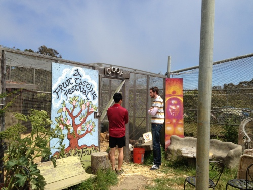 Supervisor Scott Wiener visiting with ECOSF volunteer Marcus Wong. Wong is seen explaining the student farm chicken coop.