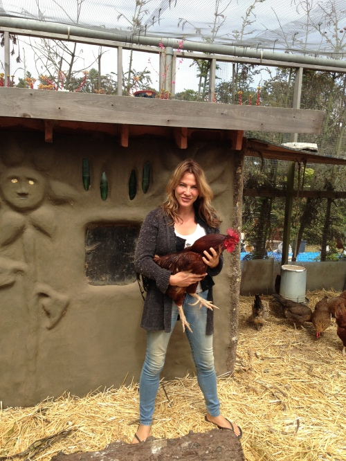 Tori Jacobs hold Jesse James, the Academy of Arts and Sciences rooster. Jesse is responsible for watching over 22 hens!