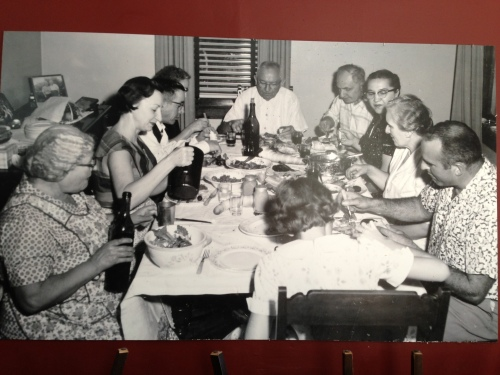 Ardiana family dinner. Gialina sits next to her daughter Rose Marie. Grandfather William sits at the head of the table and Pat, Sharon Ardiana older sister, Pat, sits at the foot of the table. Raymond Ardiana, Sharon's father, sits to Pat's right. Photo taken in 1956 in Pittsburgh.