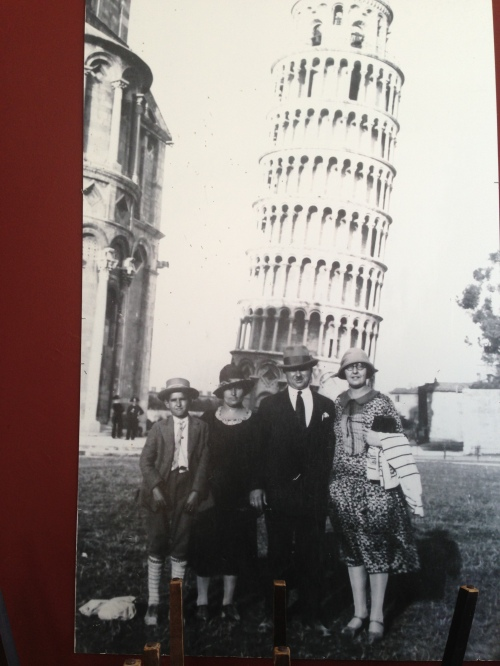 Raymond Ardiana stands next to his mother, Gialina. Behind them leans the Tower of Pizza. The Ardiana traveled back to their ancestral homeland in 1926, the year this photograph was taken. The other couple remains unidentified.
