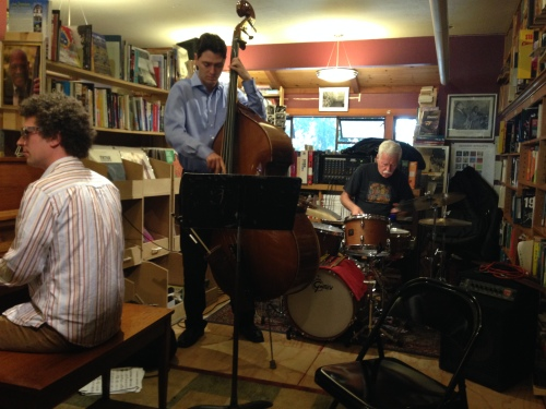 Michael Parsons on piano, Ollie Dudek on bass and Jimmy Ryan on drums, performing at Bird and Beckett's rent party.