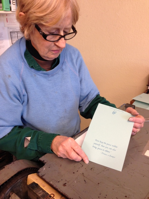Mary studying her Christmas card, one of 40 she printed on December 13.