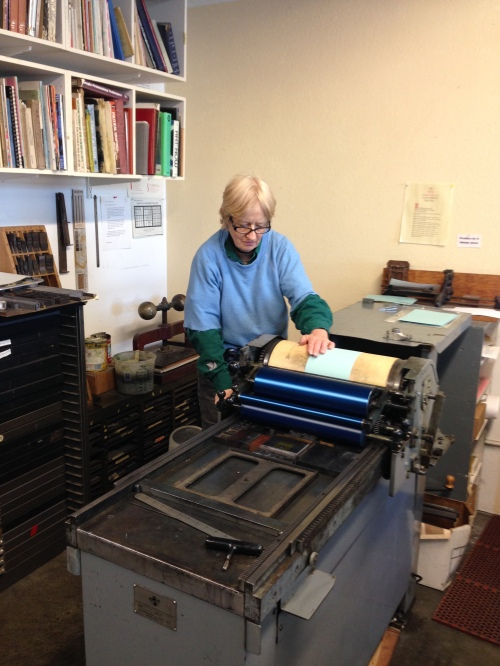 Mary printing Christmas card.