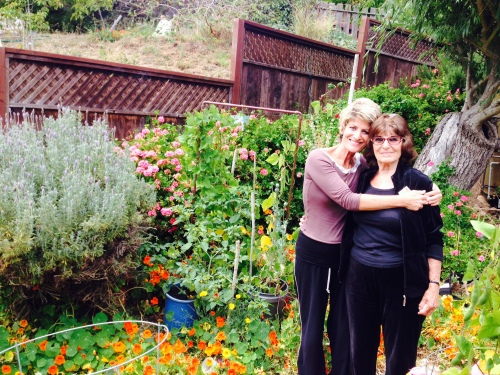 Emily and her daughter Holly in her garden on Arbor Street