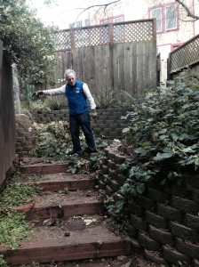 Michael Rice surveying his work and recently constructed box steps that need repair