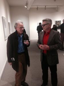 Glen Park Association president Michael Rice talking with John Priola