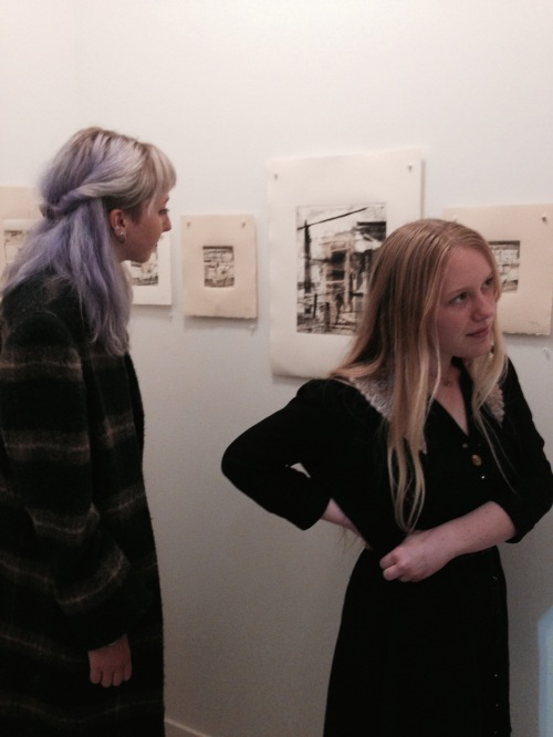 Lilly Hope and Megan Corkill, taking in Robbie Sugg's prints at Gallery Ex Libris. February 7, 2015.