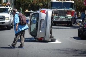 A car on is on its side after an accident on Diamond Street near Surrey Street in San Francisco. Photo: Liz Manglesdorf