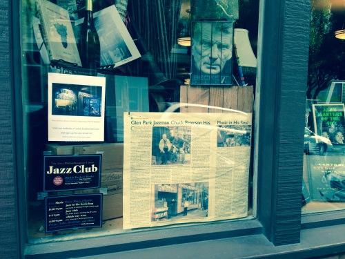 Bird & Beckett book store window, featuring a Chuck Peterson Glen Park News story