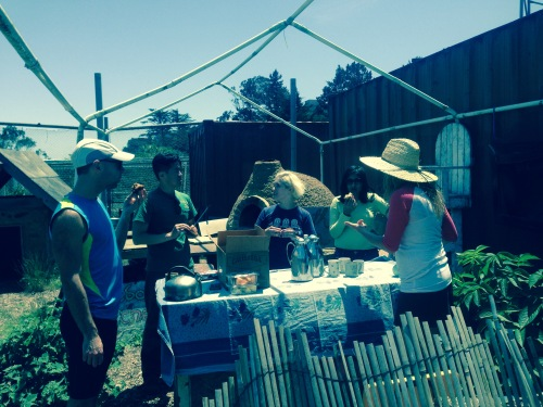 Tori Jacobs (her back turned and in a sun hat) enjoying snacks with several ECOSF volunteers.